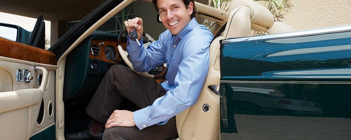 A Man Holding a Car Key